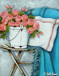 Stella Bruwer white enamel bucket coral pink roses white and coral pillow and aqua blue throw on shabby chair