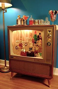 An old TV re-purposed for bar storage.