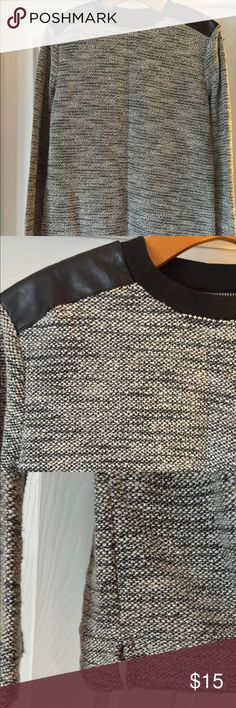 Forever 21Men Sweater Used but only wore 1 time! XS from Forever 21 Men collection Black/White/Gray Soft fabric pattern Black patch leather on shoulders Bottom of sweater has slit on each side Nice casual or formal sweater! Forever 21 Sweaters