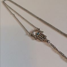 """Crystal Hamsa necklace Crystal Hamsa necklace   Adjustable clasp closure (18"""" long on shortest setting). Lightweight. NWT. Brand new with tags. Sent in original packaging. Availability- 2 Please do not purchase this listing. I have more than one of this item. I will make you your own listingNo trades. Poshmark onlyWS2J1 Jewelry Necklaces"""