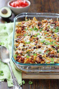 Recipe for cheesy taco casserole. A cross between nachos and enchiladas, this vegetarian casserole comes together quickly for a weeknight meal.