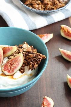 Granola is the best snack for road trips, hiking, and a tasty filling breakfast. I made this Cacao Nib Almond Granola into a breakfast bowl with Greek yogurt, honey, and figs. It was amazing! Cacao Nib Almond Granola - notjustbaked.com