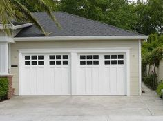 Carriage House Painted Garage Doors - Modern - Garage Doors And ...  ~ Great pin! For Oahu architectural design visit http://ownerbuiltdesign.com