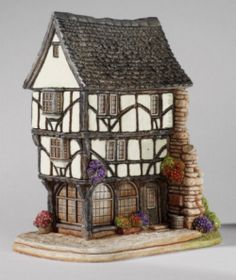"""the house that moved"" lilliput lane cottage"