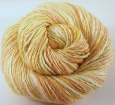 This yarn was spun from a BFL/Silk blend on my Louet spinning wheel. It has a lovely sheen and beautiful drape.I dyed the fibers using a combination of food safe and professional acid dyes. The dyes are heat set for colorfastness. Hand wash gently and dry flat.Content: BFL