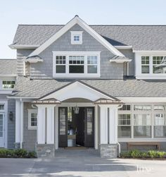 The home's shingle-style exterior gives a nod to traditional East Coast architecture. The home's shingle-style exterior gives a nod to traditional East Coast architecture. Gray House Exterior, Paint Colors For Home, Luxe Interiors, House Paint Exterior, House Painting, White Exterior Houses, House