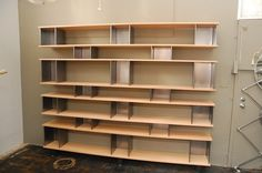 Large French industrial bookcase / shelving unit in the style of Charlotte Perriand