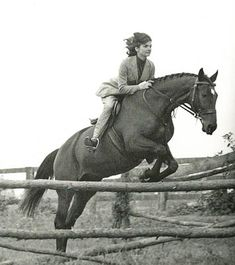 Jackie Kennedy on her horse look at the placement of those heels as she jumps.