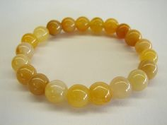 Yellow Jade - stone of assimilation & discrimination, provides joy & happiness, feeling of being loved, aids the digestive & elimination systems of the body
