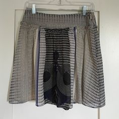 """Anthro Edme & Esyllte patterned skirt Pretty and full skirt from Anthro. No condition issues, gently worn and just dry cleaned. Side zip. Lined. Waist is 14.5"""" flat. Length is 18"""". Soft pleating. Size 0 but runs a little big. Anthropologie Skirts"""