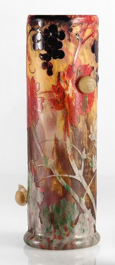 colorless glass with powdered glass inclusions in yellow, reddish orange under dark blue fused powder, acid-etched glass decorated with grapes and autumnleaves and with snail applications
