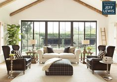 Living Spaces: Live Exquisitely Styled by Jeff Lewis (wrought iron looking accordion doors - full wall)