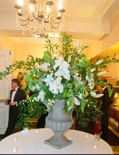 Lilies, orchids, roses, hydrangea, bells of Ireland make a beautiful arrangement for Old Well Room gallery.