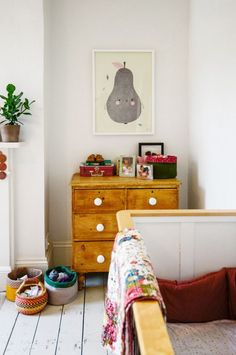 kids room with lot's of wood and small colour pops