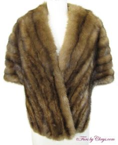 Sable Stole #SS759; $1250.00; Excellent Condition; Size estimate: XS - S. This is a beautiful genuine natural sable fur stole. It has a Siberian Fur Store - Hong Kong label and features a gorgeous solid brown silk lining with extraordinary details, which is one indication of a very high quality fur stole. The sable fur is so soft and fluffy, and it is very lightweight, yet warm. Let the enchantment begin!