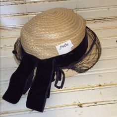 Vintage straw hat netting 1940s Beautiful Straw hat with netting around front and black velvet draped ribbon along the back. This hat comes with a glass top hat pin and is in very good condition with no major flaws. Vintage Accessories Hats