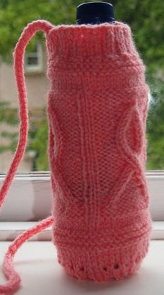 Free Knitting Pattern for Cancer Support Ribbon Water Bottle Holder - This water bottle cozy features a cable design in the shape of awareness ribbons. It's great for fund raising walks. This cozy can be made in a different color to support various causes. Designed by Diane M Scott