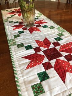 Beautiful Christmas Table Runner. Let this runner cheer up you home this Christmas! Handmade runner made with high quality quilting cottons in traditional Christmas colors graduating from light to dark In snowflake pattern. All fabrics are prewashed and color set. Machine wash and