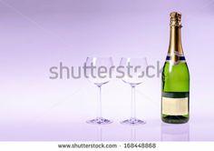 Champagen bottle with two glasses on a purple background by Kasper Nymann, via Shutterstock