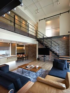 Lai Residence by PMK+Designers  Nice use of neutrals (tv placement bit strange though)
