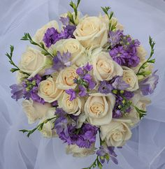 similar to my bouquet only without the green.   mine will have: ivory roses, lavender stock, and purple freesia.