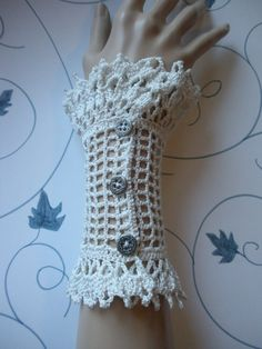 This is a beautiful pair of antique white wrist cuffs, almost a shell color, made from size 10 cotton crochet thread. They have a bit Crochet Mittens, Crochet Gloves, Cotton Crochet, Thread Crochet, Crochet Crafts, Crochet Lace, Crochet Projects, Crochet Wrist Warmers, Arm Warmers