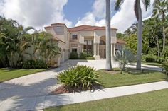 Spectacular water view from this 2 story residence in the exclusive community of Point Manalapan.