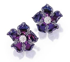 PAIR OF TITANIUM AND DIAMOND EARCLIPS Designed as flowerheads composed of purple-hued titanium, decorated with round and briolette diamonds weighing approximately 9.60 carats.