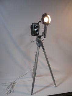 Vintage tripod and camera lighting