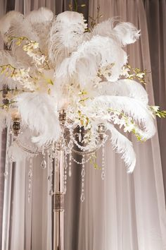 """ostrich feathers used beautifully with florals have created an incredibly elegant wedding centerpiece!  Get your 17""""-21"""" ostrich feathers for just $1.99 each including shipping at Event-Warehouse.com"""