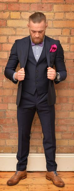 stylish Conor McGregor in designer suit : if you love #MMA, you'll love the #UFC & #MixedMartialArts inspired fashion at CageCult: cagecult.com/fitness