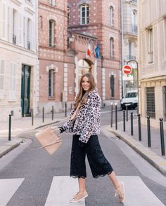 Julia Engel shares her daily look on Gal Meets Glam. Julia is wearing a Rebecca Taylor jacket, Kate Spade pants, Lanvin sneakers, and more. Click to shop!