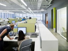 Open plan office - nice use of green + grey w/ partitions