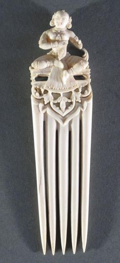 319 - A COMB DEPICTING SARASWATI South India, 17th/18th century carved ivory, made in two pieces, the god... Plaited Ponytail, Art Indien, World Hair, Tribal Hair, Black Pigment, Hair Combs, Vanitas, South India, Unique Hairstyles