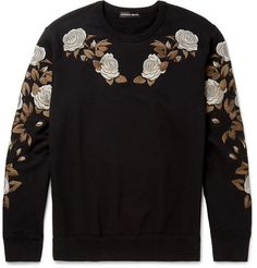 Ornate floral embroidery is a key feature of Alexander McQueen's latest collection. This sweatshirt is decorated on the shoulders and sleeves with lustrous silver, fawn and chocolate roses. Crafted from black cotton-jersey and backed in looped terry for the softest handle, it has a sporty, semi-fitted cut and ribbed trims. Give yours a sharp contrast with tailored trousers.