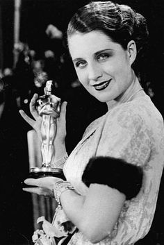 """Actress Norma Shearer poses with her Oscar at the Academy Awards banquet in the Fiesta Room, Ambassador Hotel in Los Angeles, Ca., Nov. 5, 1930. Shearer won for the best performance given by an actress for the movie """"The Divorce."""" (AP Photo)"""