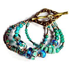 Blue Green Boho multi strand bracelet, Emerald Green Bohemian Lampwork... ($52) ❤ liked on Polyvore featuring jewelry, bracelets, bohemian bangles, green jewelry, bohemian style jewelry, boho jewelry and boho jewellery