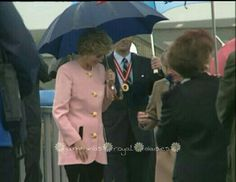 Very Rare - September 23, 1992: Princess Diana at the opening (inauguration) of new Bridge, Infinity Bridge, in Stockton on Tees, Teeside, England. Later often referred to informally as The Princess Diana Bridge. It is raining so the Princess of Wales carries an umbrella. Diana is wearing: a pink jacket with gold buttons, and the pockets have a black edging contrast, and a black skirt for the event.