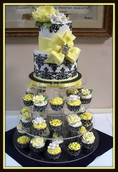 black and yellow damask cupcake tower                     This would be at my wedding