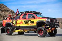 These life-size Tonka toys — lifted versions of the Toyota Tundra pickup and Ford truck — make appearances at off-road motorsports events around the country to help promote Tonka's legendary brand. Toyota Tundra Lifted, Toyota 4x4, Toyota Trucks, Toyota 4runner, Chevrolet Trucks, Ford Trucks, 1957 Chevrolet, 4x4 Trucks, Diesel Trucks