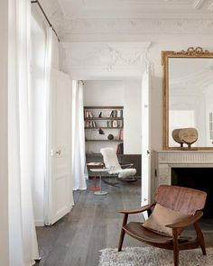 Sergio Rodrigues chair. Love the floor, walls, chair, mirror