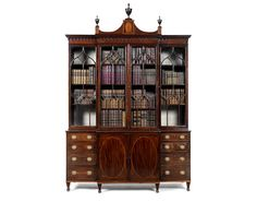 A George III mahogany and tulipwood crossbanded breakfront bookcase