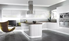 Kitchens   Wickes - this one is nice.  no handles, gloss white, even like the floor and counter
