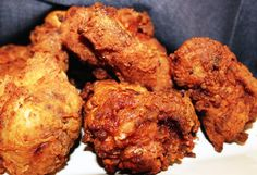 Creole Fried Chicken... 1 whole chicken (about 5 pounds) cut into 8 pieces Essence 2 cups Creole Mustard 2 cups all-purpose flour 2 eggs, beaten 2 tablespoons milk Oil for frying