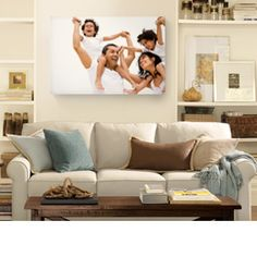 Another great display of a family portrait, love the display of pictures on the side also. Family Canvas, Family Wall, Family Room, Large Canvas, Large Family Portraits, Family Photos, Photos Onto Canvas, Canvas Artwork, Canvas Prints