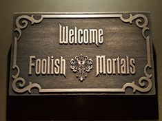 """haunted dollhouse Inspired by the Haunted Mansion ride this sign features the iconic quote """" Welcome Foolish Mortals"""" cast in resin and bronze powder this plaque measures approximate Haunted Mansion Decor, Haunted Mansion Halloween, Theme Halloween, Disney Halloween, Halloween Decorations, Haunted Mansion Disney, Halloween Prop, Halloween Witches, Haunted Houses"""