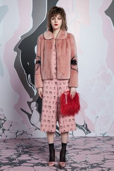 8/28/16 I chose this image because I love the textural contrast between woven and fur in an outfit that happens to be uni colored. Shrimps RTW Fall 2016 - more fluff and nonsense.