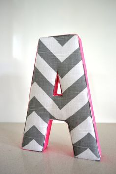 Wall Art – Personalized Fabric Letter A in Grey with Hot Pink Ribbon. $20.00, via Etsy. Children Housewares Room Decor alphabet personalised nursery decor baby toddler girl boy custom letters Chevron Fabric Letter A Wall Art Hot Pink Ribbon Grey Chevron