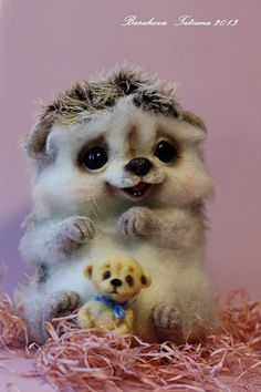 Needle felted Hedgehog and teddy bear by Tatiana Barakova.