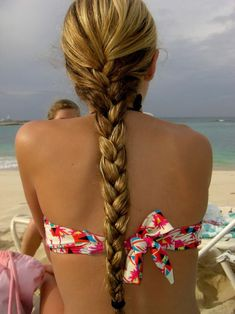 Tight Braid, but I feel a fish tail would go perfectly with her hair length and colour